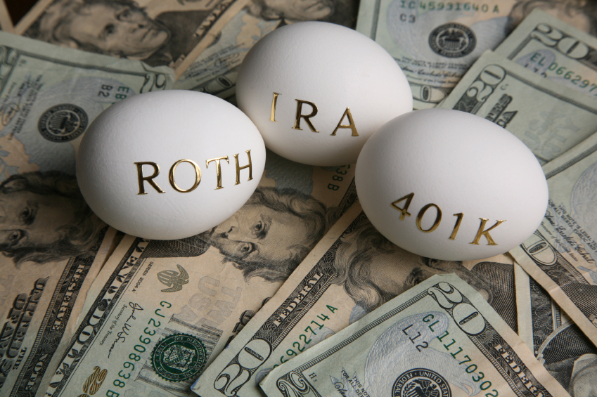 Roth IRA 401k nest eggs on a stack money