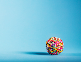 Rubberband ball on blue background