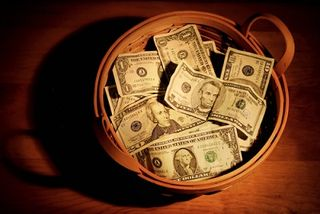paper money in a basket